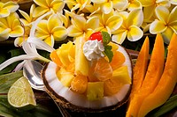 Studio shot of a tropical fruit salad with flowers