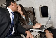 Businesspeople Kissing on Airplane