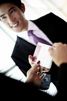 Businessman Getting Airline Ticket