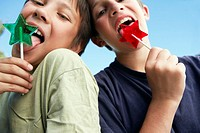 Two Boys Licking on Star-Shaped Lollipops