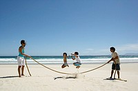 Family Jumping Rope on the Beach