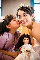 Girl Receiving Kiss at Quinceanera Celebration