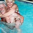 Older Couple Playing in Pool (thumbnail)