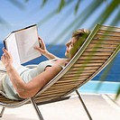 Woman Reading on Beach (thumbnail)