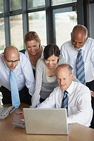 Businesspeople looking at laptop computer