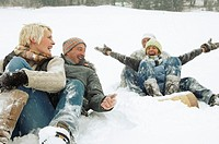 Couples sledding together