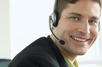 Businessman with telephone headset (thumbnail)
