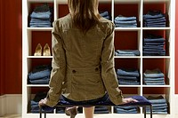 Woman looking at display of jeans