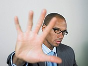 Businessman with hand up