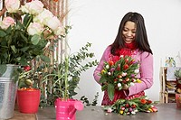 Florist holding bunch of tulips