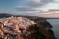 Greece, Santorini, Fira, cityscape, elevated view, dusk
