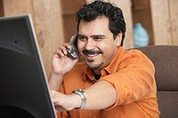 Hispanic man talking on cell phone