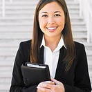 Close up of Mixed Race businesswoman smiling