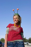 Young woman with football headband at tailgate party