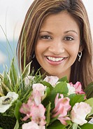Indian woman next to flower bouquet