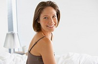 Woman indoors smiling
