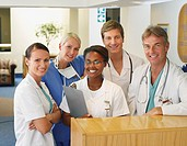 Nurses and doctors standing and smiling