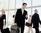 Male business traveler with cell phone