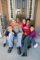 African family sitting on front steps