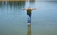 Man standing on water about to jump