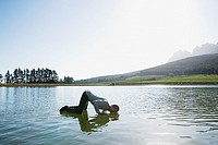 Man kneeling on water and listening