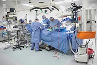 Surgeons performing surgery in operating room