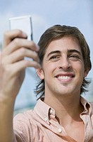 Young man looking at cell phone
