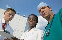 Multi-ethnic medical professionals outdoors