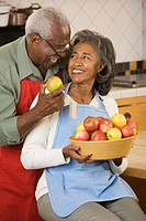 Senior African couple with bowl of fruit