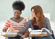 Two female college students studying in class