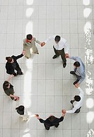 Aerial view of businesspeople in circle holding hands