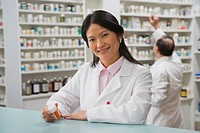 Asian female pharmacist in pharmacy