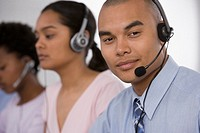 Multi-ethnic businesspeople wearing headsets