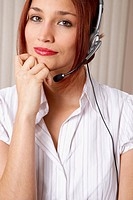 Native American businesswoman wearing headset