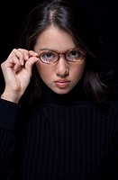 Portrait of Hispanic woman wearing eyeglasses