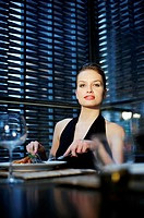 Woman enjoying her meal in a luxurious restaurant