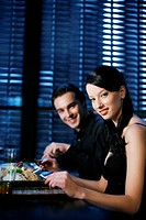 Couple enjoying their meal in a luxurious restaurant