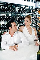 Man and woman enjoying red wine