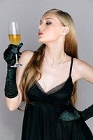 Woman in black holding a glass of champagne
