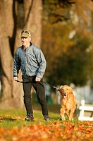 Rollerblader walking dog