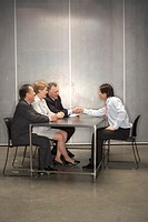 Businesspeople making a deal