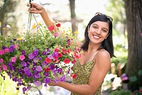 Indian woman hanging flower basket