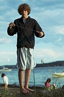 Young boy playing with yo-yo on beach