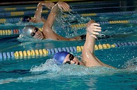 Swimmers racing in swimming pool