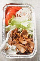 D&#246;ner kebab with vegetables in aluminium dish
