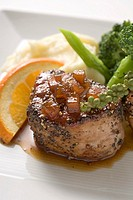 Peppered pork tenderloin in orange sauce