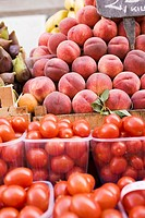 Tomatoes and peaches at a market (thumbnail)