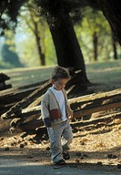 Young boy walking outdoors