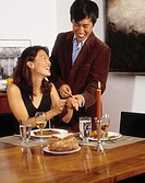 Asian couple at dinner