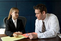 Young girl and businessman talking
